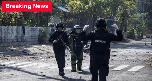 Indonesian bomb squade examine the site following a suicide bomb outside a church in Surabaya early Sunday. Ralph Ellis and Kathy Quiano , CNN