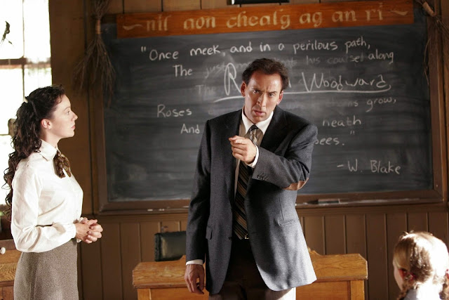 Nicolas Cage teaches the class how to point at things that you want, but don't have the money for. Just off screen is the skull of a dinosaur.