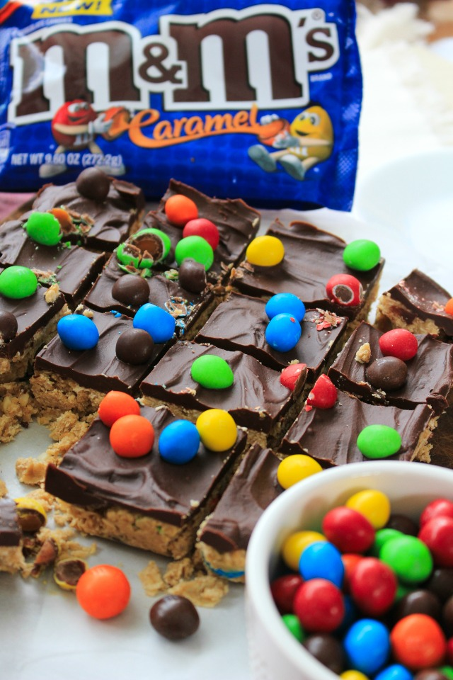 Chocolate Caramel Oatmeal Cookie Bars are a delicious no-bake sweet treat made with a fudge-like oatmeal cookie base, a silky chocolate topping, and lots of M&M'S® Caramel! #UnsquareCaramel #AD
