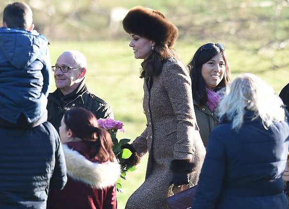 The pregnant Duchess is wearing Moloh's Turpin coat and Russian style fur hat. Tod's Pumps and carries Chanel bag from Paris