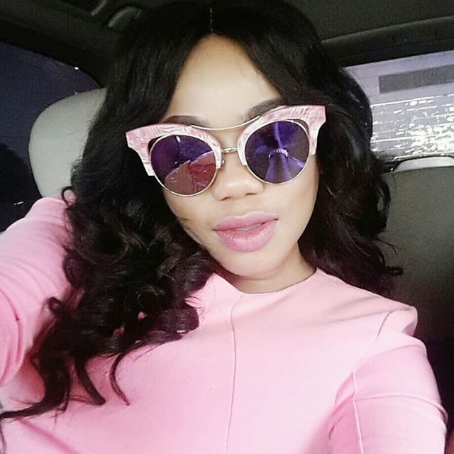 Toyin Lawani Wears Sexy Pink Dress To Match Her Pink Car