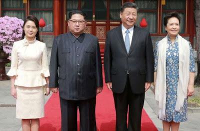 Berkunjung Ke China Kim Jong UN Tampil Modis