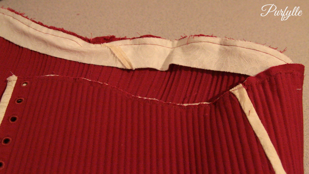 bias binding stitched to the top edge of the corset