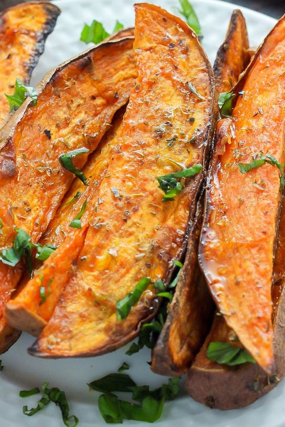 Thick and crispy oven baked sweet potato wedges! A delicious snack or side.