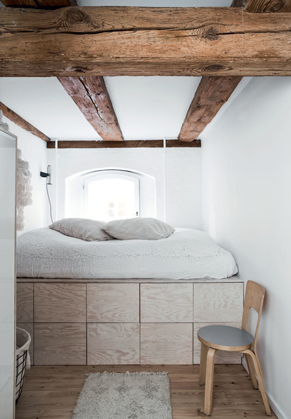 Rustic bed nook with plywood storage drawers under bed. Styling by Mette Helena Rasmussen, photo by Tia Borgsmidt via Bolig