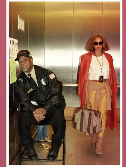 Beyonce poses with elevator man