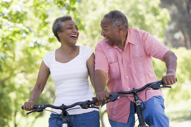 Middle-aged couple enjoying a bike ride