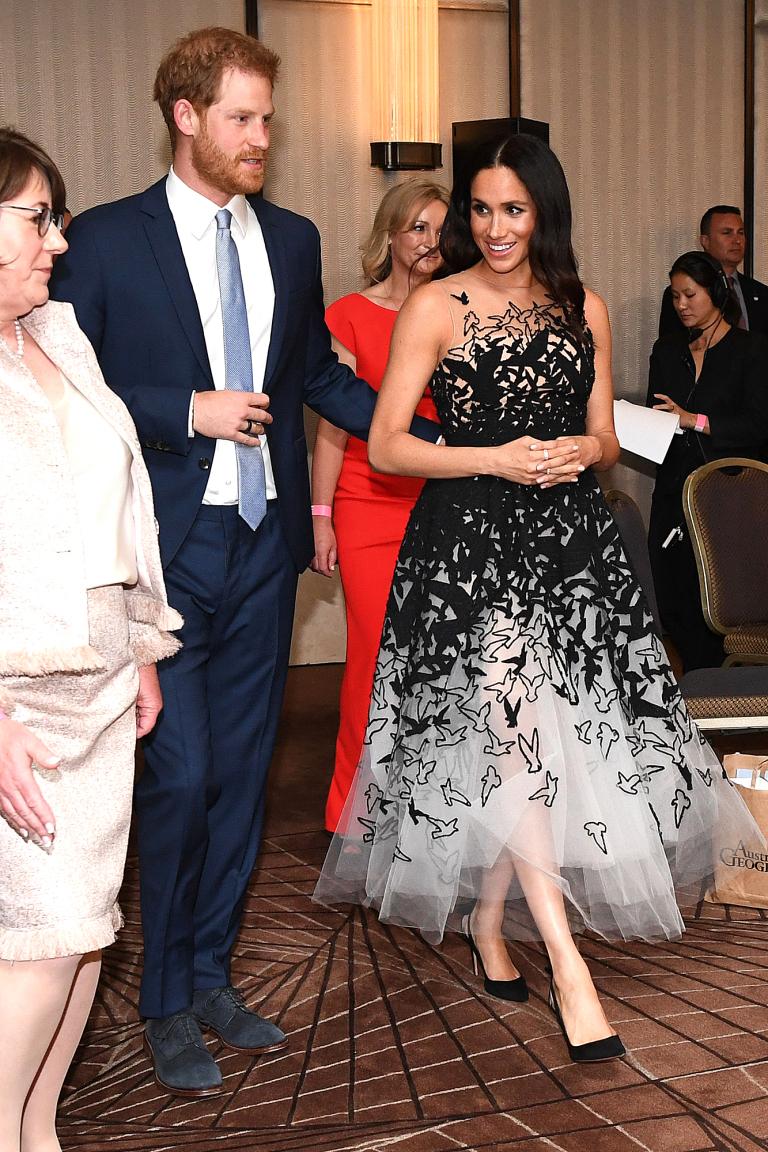 Pregnant Meghan dazzles in stunning £10,000 Oscar de la Renta gown
