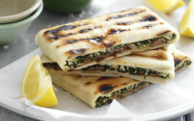 Lamb, cheese and spinach gözleme in a serving dish