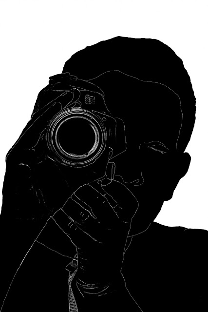 silhouette of a man with camera