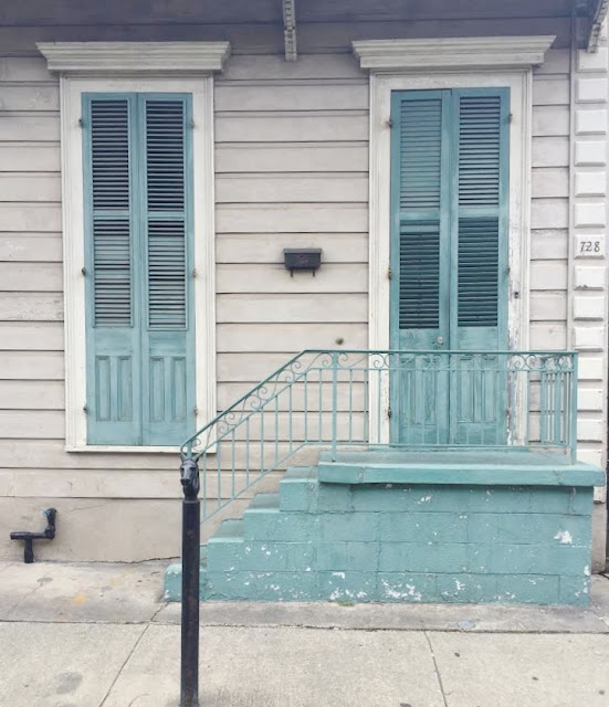Blue shutters on old building in New Orleans French Quarter
