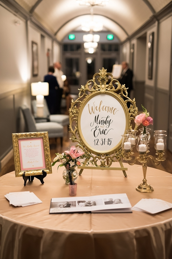 Glitz and glamour new years eve wedding guests were greeted at the entrance to the reception by gold party horn place cards and tins of happy new years headbands to set the tone for the evening junglespirit Choice Image