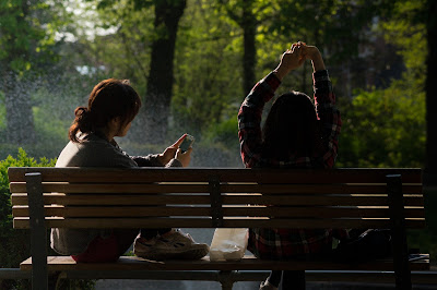 two girls sat on a bench