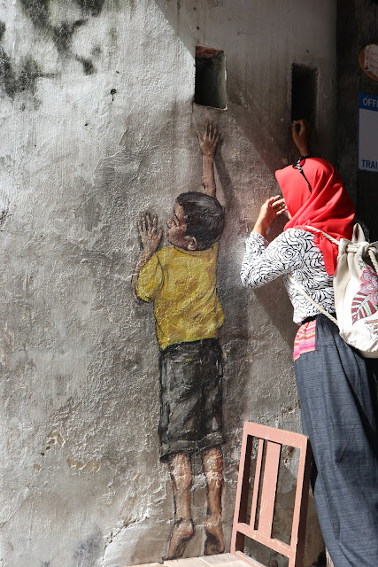 boy reaching up, mural street art Penang