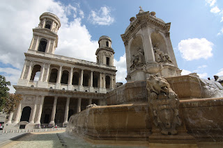 the square of the church of Saint Sulpice with its Source, where cafes and terraces abound.