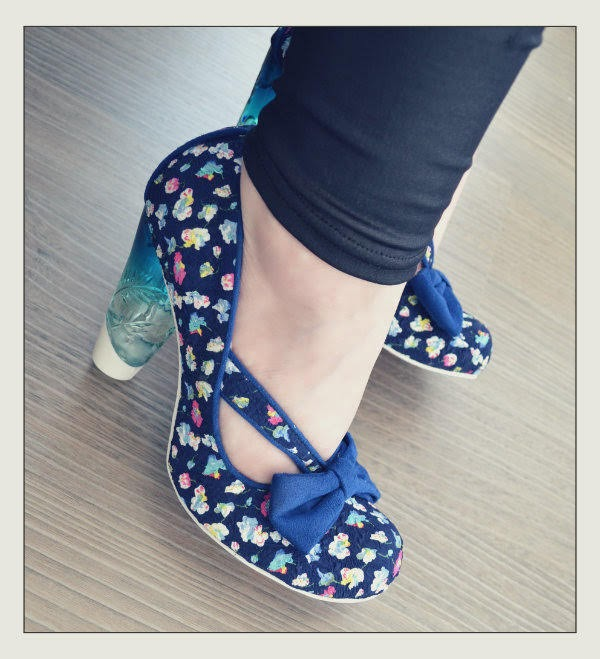 wearing navy ditsy floral print shoes with perspex heel