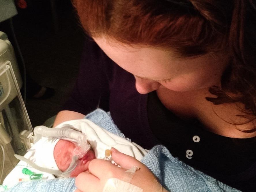 mum-holding-premature-baby