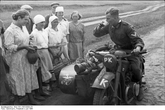 Wehrmacht motorcyclist with Ukrainian women, 23 July 1941 worldwartwo.filminspector.com