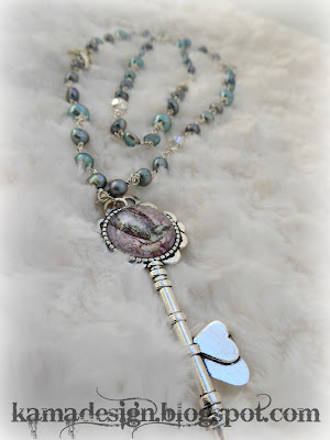 Bird key cabochon necklace