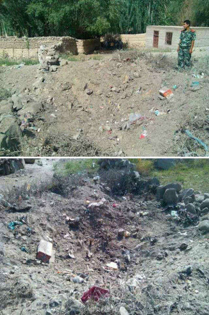 This photo taken on August 1, 2013, shows the dump site which was hit by a meteorite in a village of Akto County of northwest China's Xinjiang Uygur Autonomous Region. [Photo: Weibo]