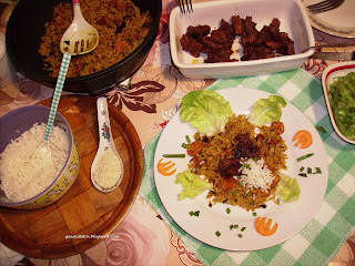 Rice with vegetables and meat  (green lettuce, carrots, green onions and sesame seeds)  White rice and seasoned rice with dwaeji bulgogi