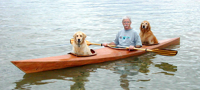 """We've gone miles and miles of paddling with our dogs"" - Man Built Custom Kayak So He Could Take His Dogs On Adventures"
