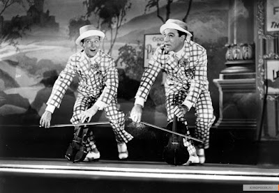 """""""Поющиепод дождем""""  1952 г.  реж. Стенли Донен, Джим Келли."""