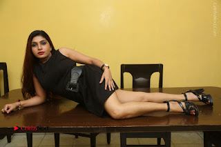 Tollywood Upcoming Actress Pooja Roshan Stills in Black Short Dress at Plus 1 Movie Trailer Launch  0366.JPG
