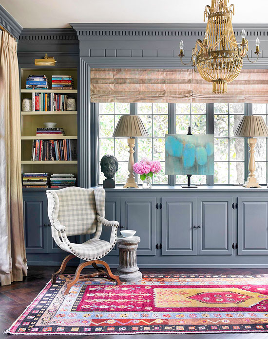 Library blue cabinetry elegant gold chandelier
