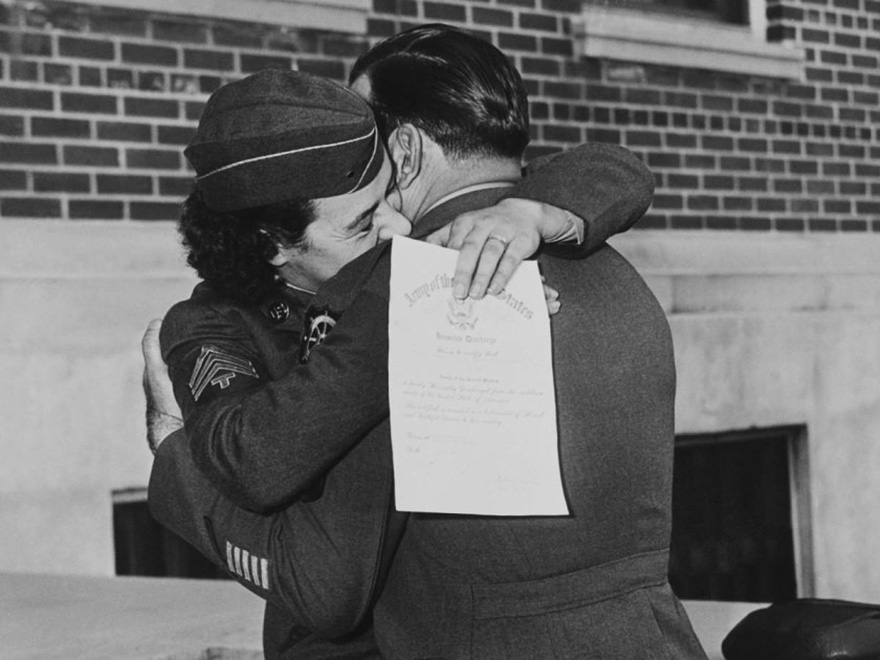 60 + 1 Heart-Warming Historical Pictures That Illustrate Love During War - Women's Army Corp Member Kissing Her Husband, Upon Discharge January 1, 1945