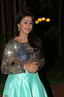 Nikki Galrani in Green Skirt  Top at Marakathamani music launch ~  Exclusive (71).JPG