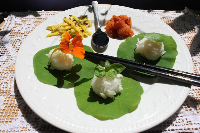 organic sushi with nasturtium leaves