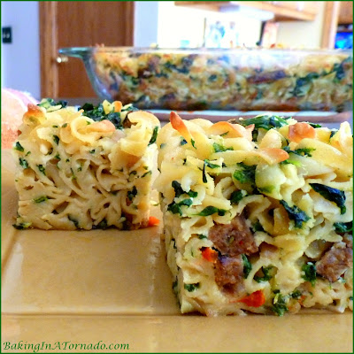 Spicy Sausage and Noodle Squares, wide noodles and hot sausages baked and sliced. Serve for lunch, dinner, or as a side dish | Recipe developed by www.BakingInATornado.com | #recipe #dinner #lunch