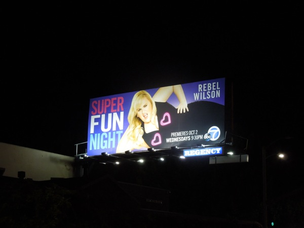 Illuminated Super Fun Night billboard at night