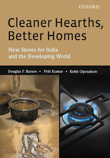 Book cover with a picture of tranditional woodstove beside a gas stove.