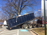 The dumpster is hauled away
