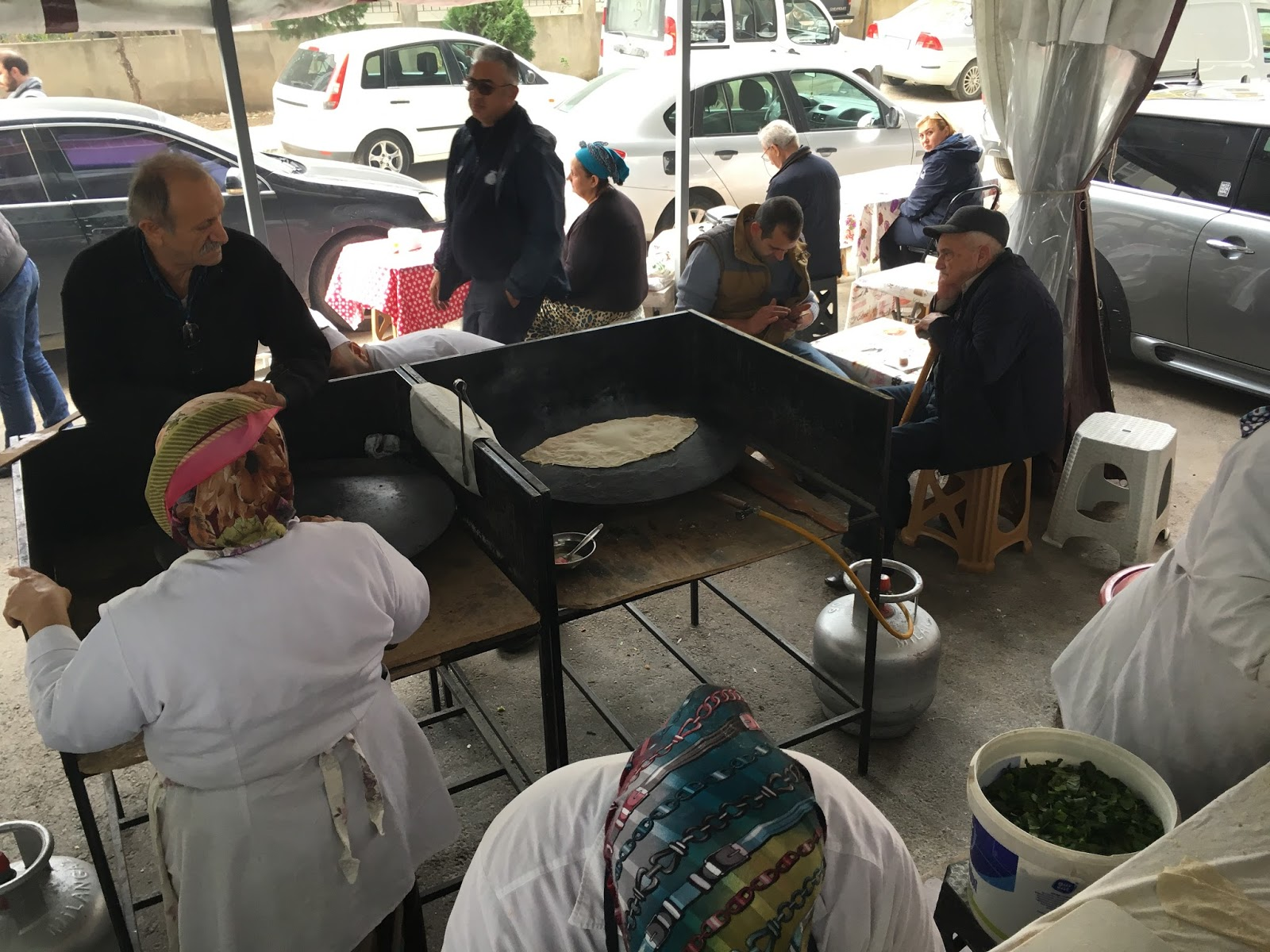 LeeZe visits Izmir Sunday farmer's market. The stuffed dough is place on this gas fired hot plate and is cooked for about 3 minutes.