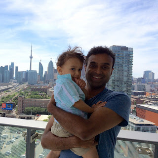 Malli and Tim with view of CN Tower in Toronto