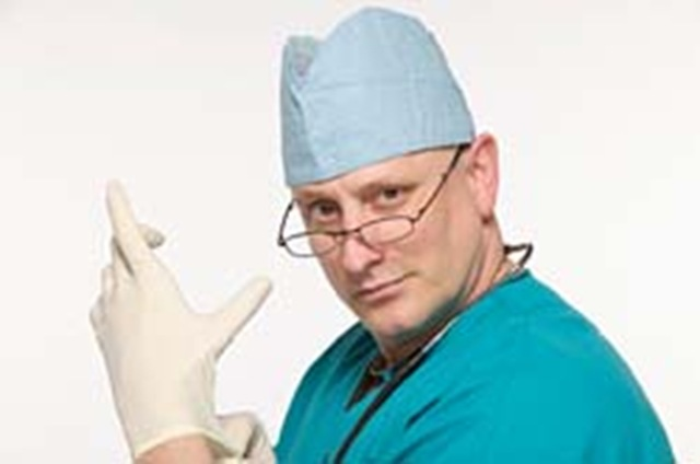 doctor with one glove