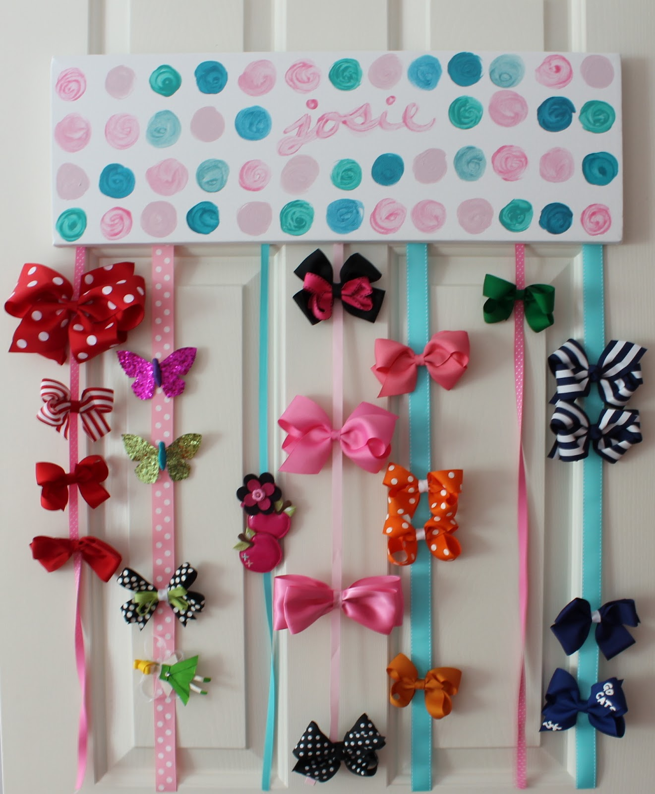 How to organize hair bows - I Painted This Made By Girl Inspired Canvas And Stapled Ribbons To The Back To Hold Her Hair Bows