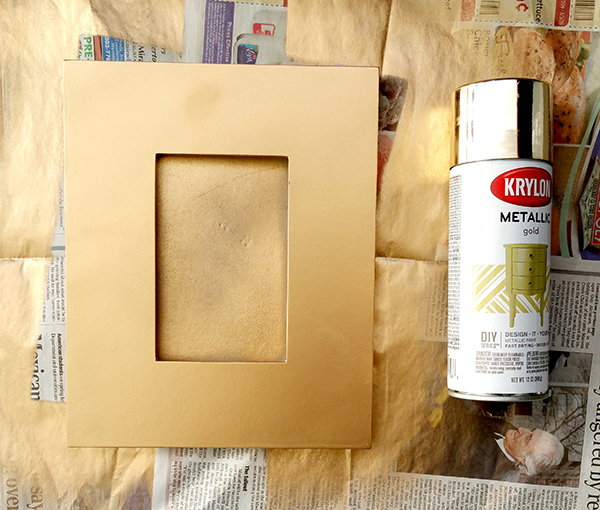 1 can of krylon metallic gold spray paint and 1 gold picture frame