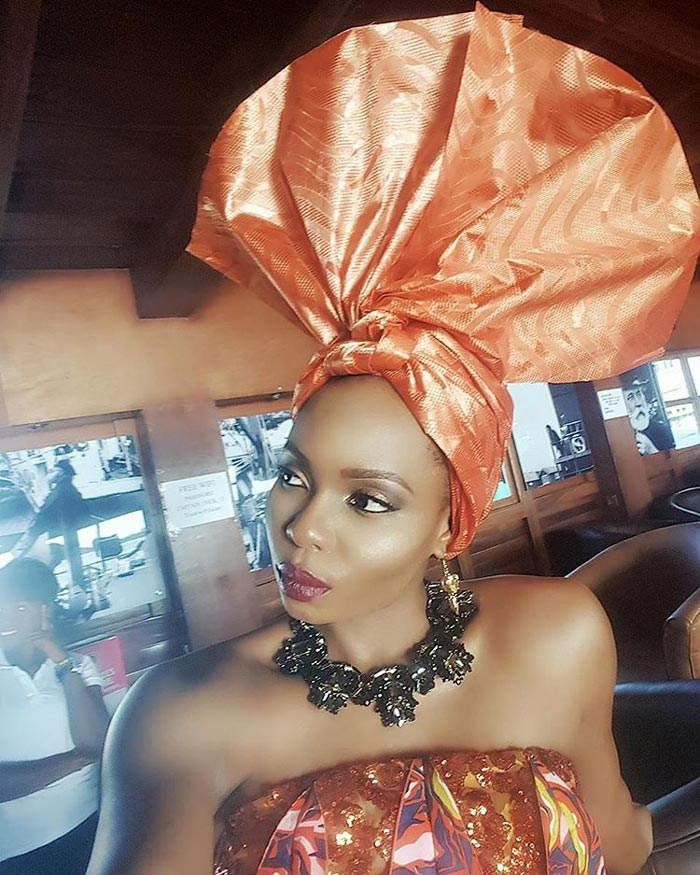Yemi Alade in African headtie is a sight in behold