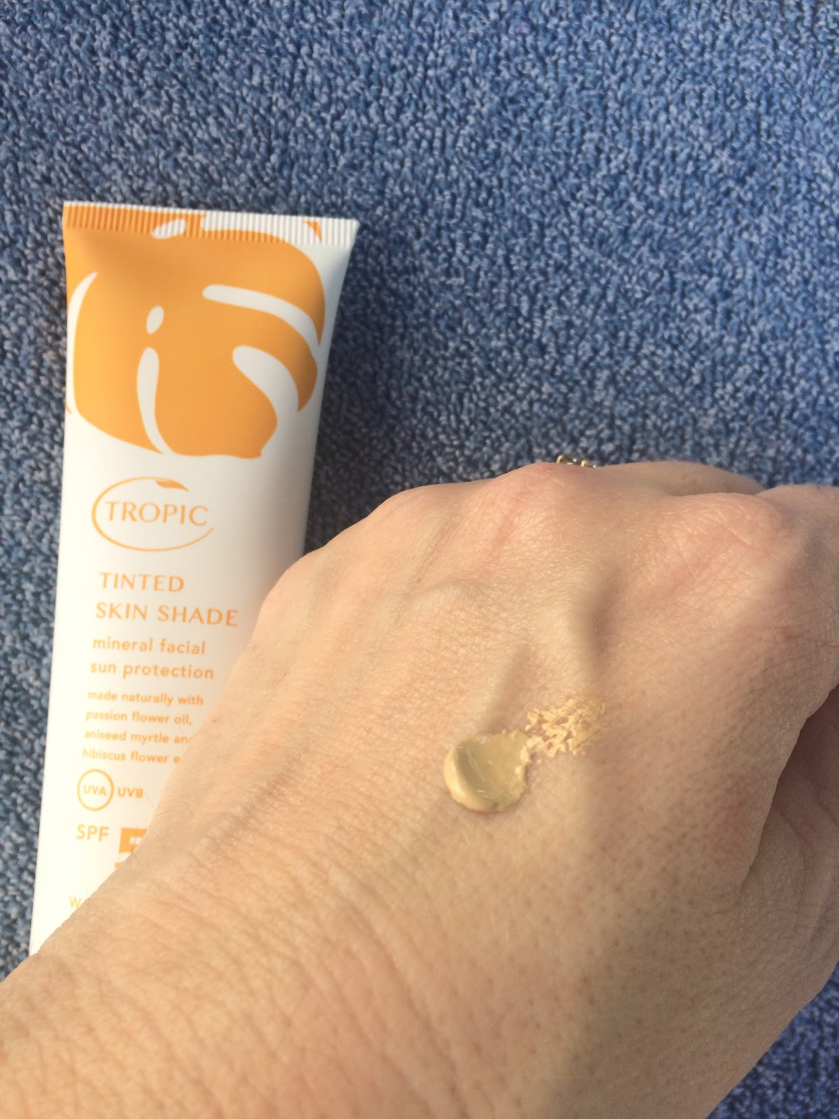 Tropic Skin Care Tinted Skin Shade on hand