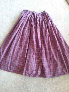 Gauged petticoat of plaid cotton, for mid-Victorian working wear (reproduction).