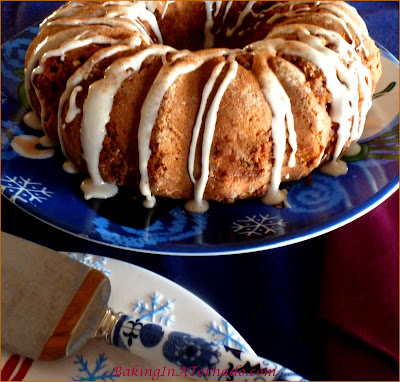 Sweet Potato Pecan Cake with Maple Glaze, a moist holiday cake with a hint of sweet potato, a cinnamon ,maple swirl center and a hint of maple maple in the glaze. | Recipe developed by www.BakingInATornado.com | #recipe #cake #holiday