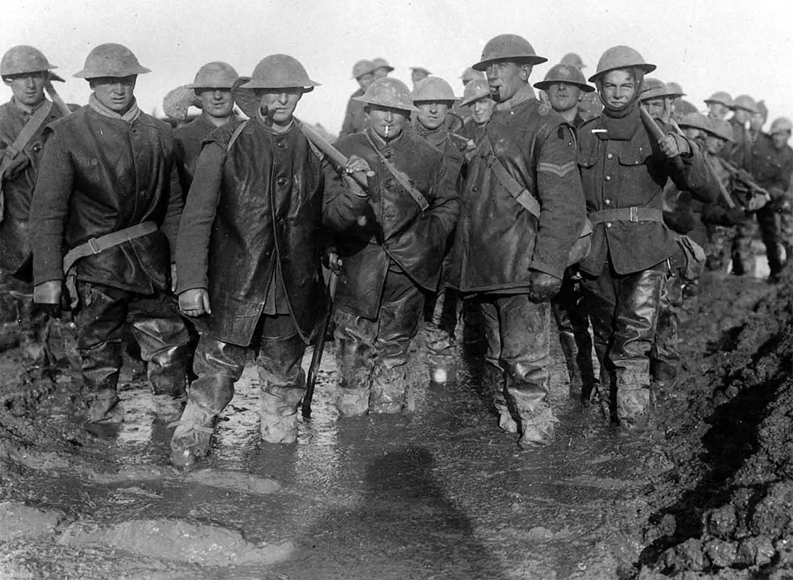 British soldiers standing in mud on the French front lines, ca. 1917.