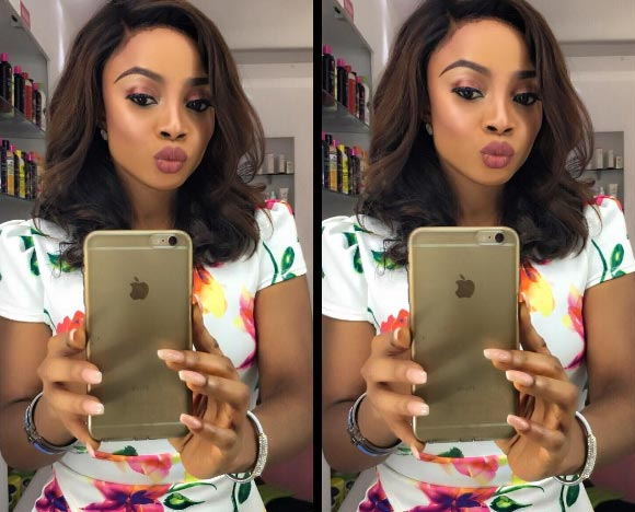 "Fans of Toke Makinwa slam female follower for calling her a lesbian with ""smelly"" privates"