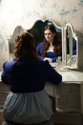 Sophie Andrews looking in the mirror