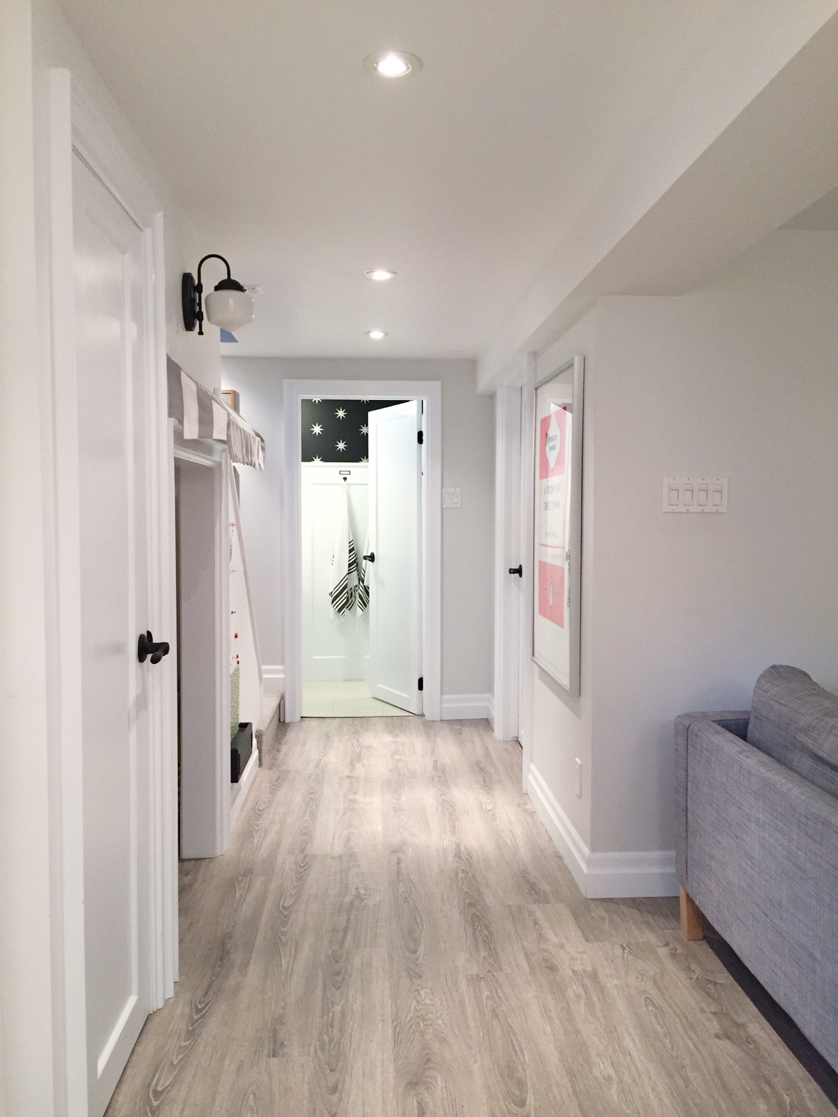 bright white basement | Kamina Oak laminate | ramblingrenovators.ca