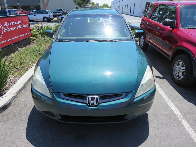 Shiny Honda after getting repainted at Almost Everything Auto Body.